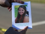 A mourner displays a program for the funeral of slain teacher Victoria Soto on Dec. 19. (credit: John Moore/Getty Images)